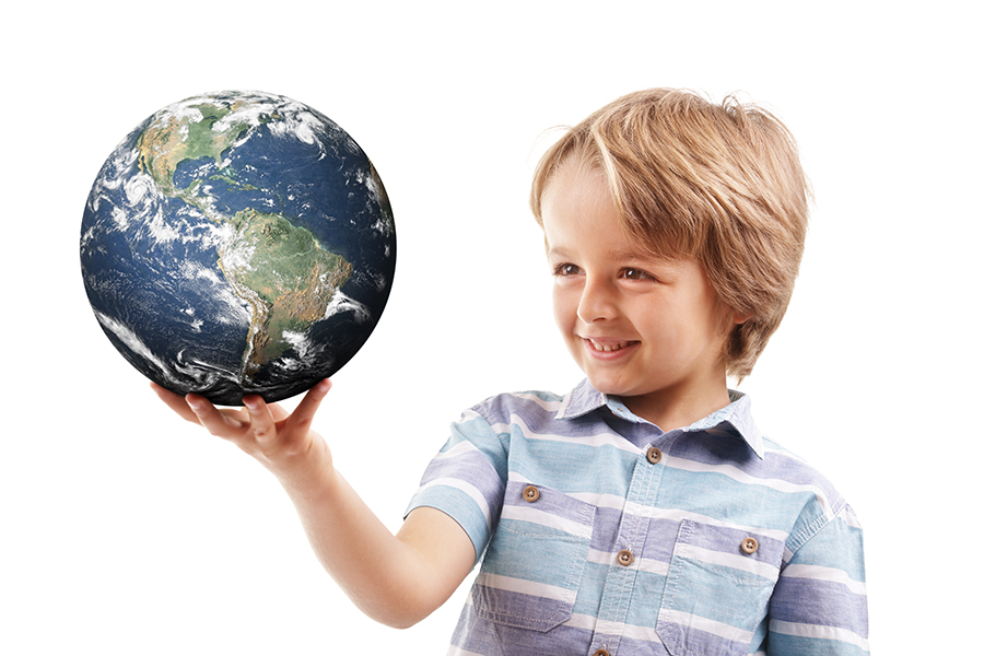 Young boy holding world in the palm of his hands concept for education, travel, communications, politics or environmental conservation  Earth image courtesy of Nasa at http://visibleearth.nasa.gov